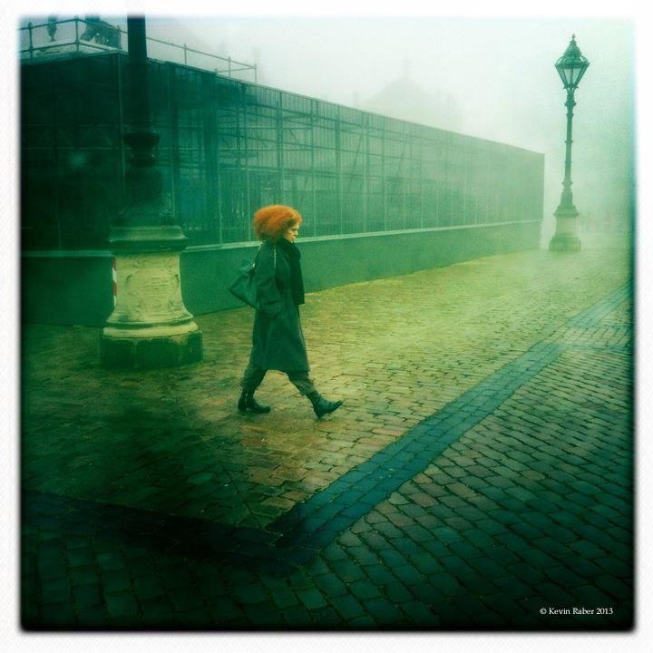 Woman walking in fog, Copenhagen, Denmark