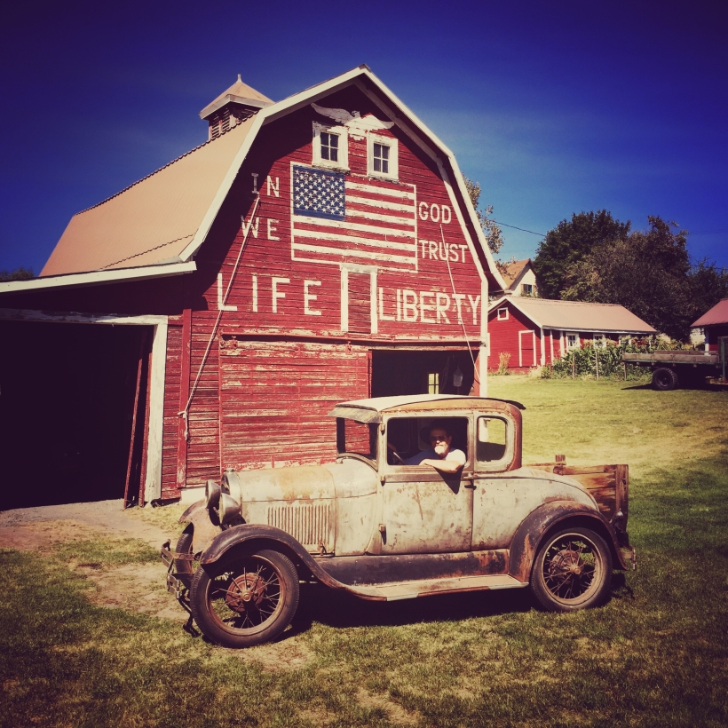 Nice guy, old car and old barn in the Palouse